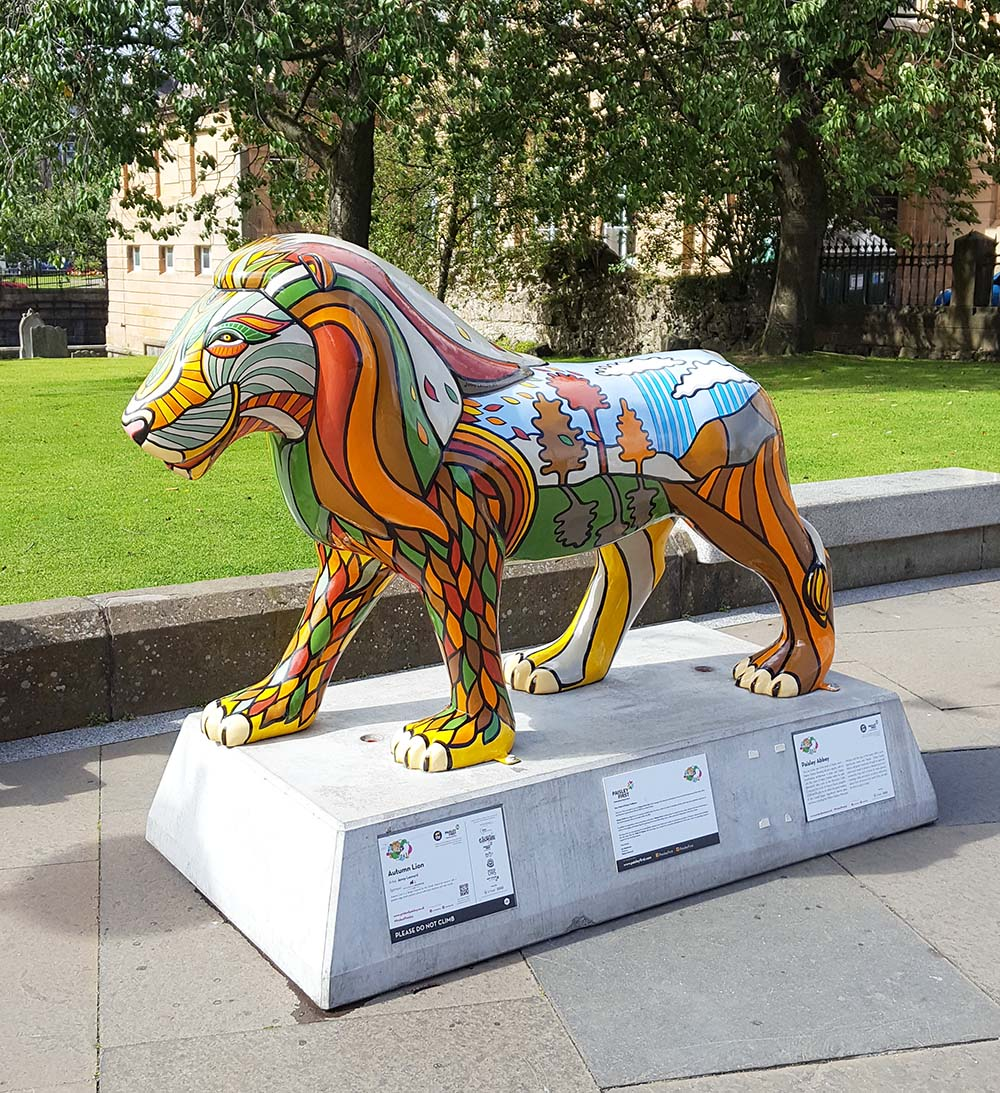 A 'Pride of Paisley' lion outside Paisley Abbey